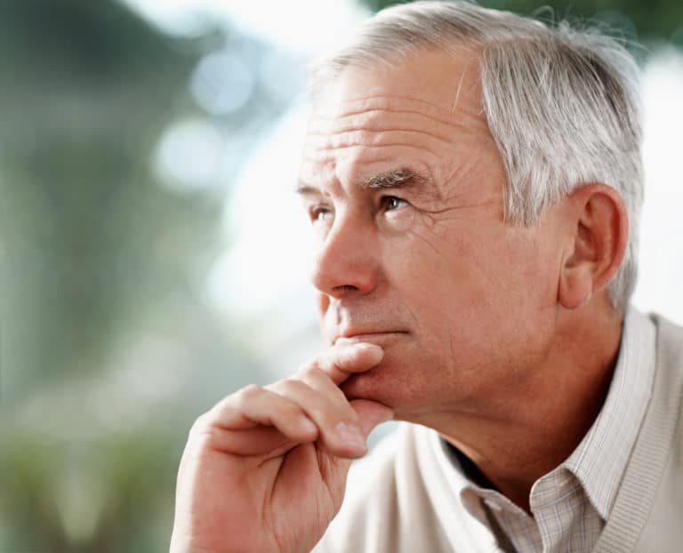 Contemplative senior man looking away